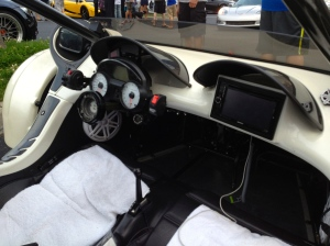 No steering wheel, touch screen navigation and of course towels over the seats to protect it from the rain.