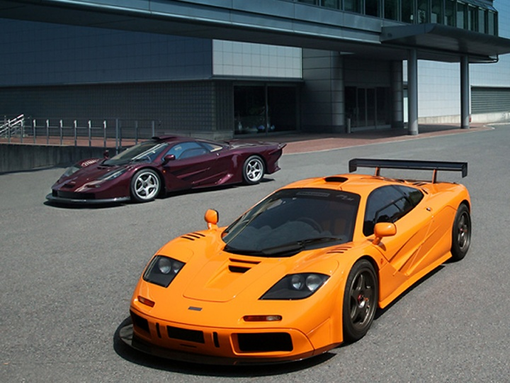 The McLaren F1 LM (Papaya Orange) and the F1 GT LongTail (Burgundy)